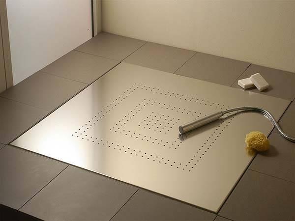 Как сделать слив в полу для душа